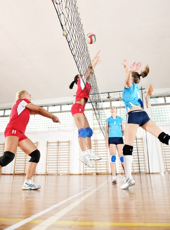 volleyball game sport with group of young beautiful  girls indoor in sport arena Stock Photo - 10650145