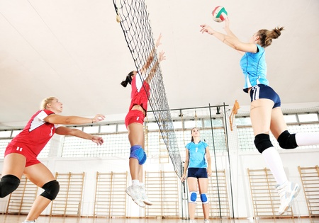 volleyball game sport with group of young beautiful  girls indoor in sport arena Stock Photo - 10650131