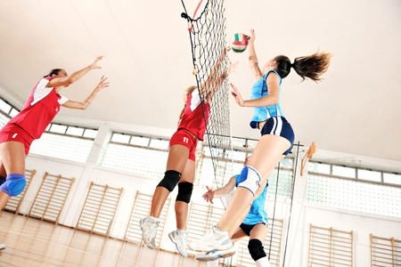 volleyball game sport with group of young beautiful  girls indoor in sport arena Stock Photo - 10650160