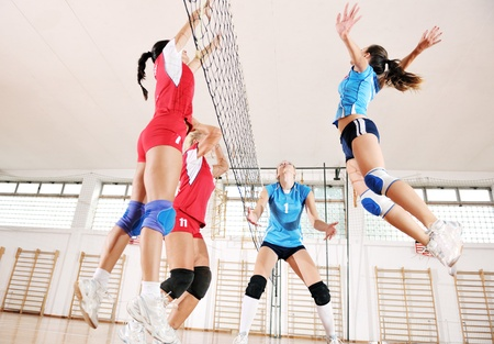 team winner: volleyball game sport with group of young beautiful  girls indoor in sport arena Editorial