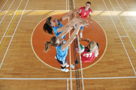 volleyball game sport with group of young beautiful  girls indoor in sport arena Stock Photo - 10650220