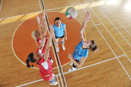 volleyball game sport with group of young beautiful  girls indoor in sport arena Stock Photo - 10650207