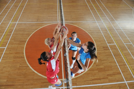 volleyball game sport with group of young beautiful  girls indoor in sport arena Stock Photo - 10650195