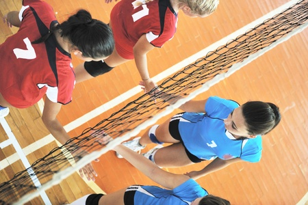 volleyball net: volleyball game sport with group of young beautiful  girls indoor in sport arena Editorial