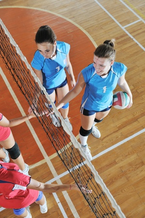 volleyball game sport with group of young beautiful  girls indoor in sport arena Stock Photo - 10650201