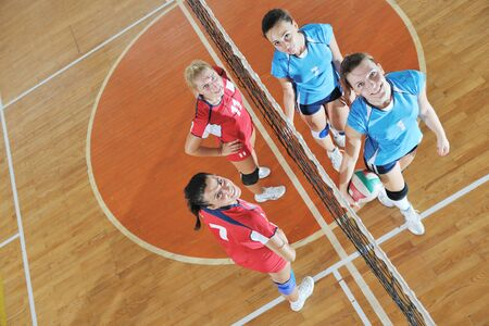 volleyball game sport with group of young beautiful  girls indoor in sport arena Stock Photo - 10650198