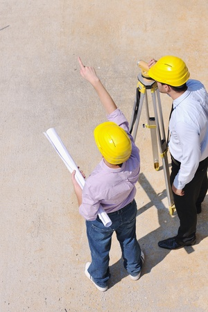 Team of business people in group, architect and engeneer  on construciton site check documents and business workflow on new building Stock Photo - 10665782