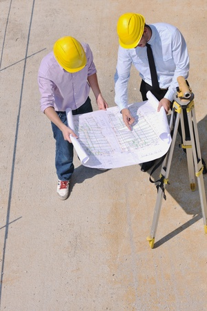 Team of business people in group, architect and engeneer  on construciton site check documents and business workflow on new building Stock Photo - 10665812