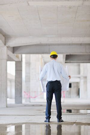 construction site helmet: business man Architect engineer manager at construction site project Stock Photo