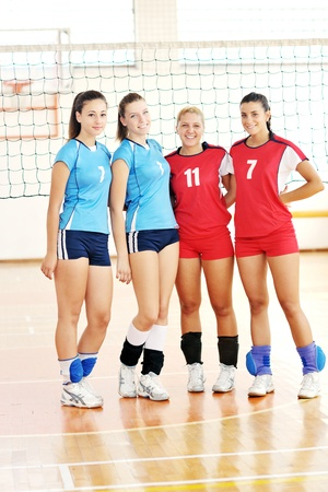 volleyball game sport with group of young beautiful  girls indoor in sport arena Stock Photo - 10650126