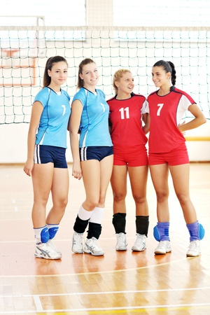 volleyball game sport with group of young beautiful  girls indoor in sport arena Stock Photo - 10650127