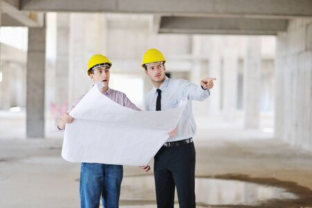Team of business people in group, architect and engeneer  on construciton site check documents and business workflow on new building Stock Photo - 10778229