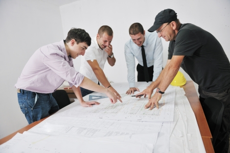 Team of business people in group, architect and engeneer  on construciton site check documents and business workflow on new building Stock Photo - 10778207