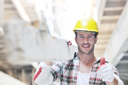 laborer: handsome hard worker people portrait at concstruction site Stock Photo