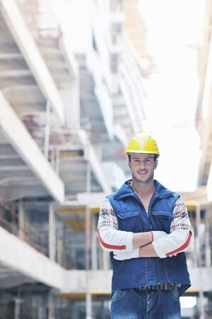 hard look: handsome hard worker people portrait at concstruction site Stock Photo