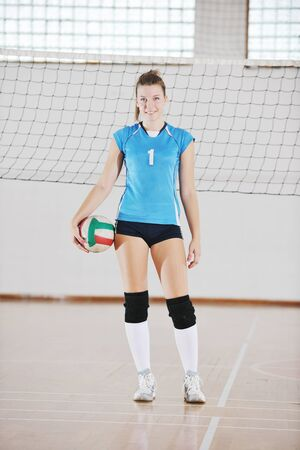 one young girl playing volleyball game sport  indoor Stock Photo - 10778222