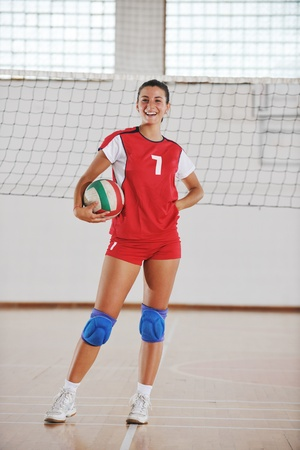 one young girl playing volleyball game sport  indoor Stock Photo - 10778232