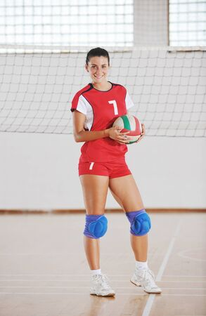 one young girl playing volleyball game sport  indoor Stock Photo - 10778216