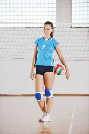 one young girl playing volleyball game sport  indoor Stock Photo - 10778217