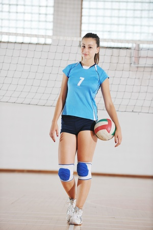 one young girl playing volleyball game sport  indoor Stock Photo - 10778230