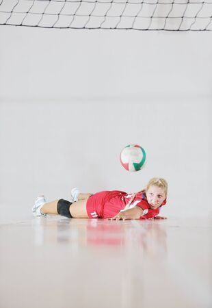 one young girl playing volleyball game sport  indoor Stock Photo - 10778234