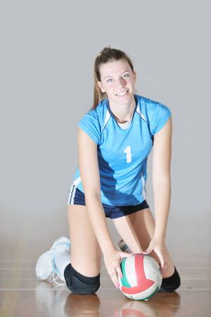 one young girl playing volleyball game sport  indoor Stock Photo - 10778221