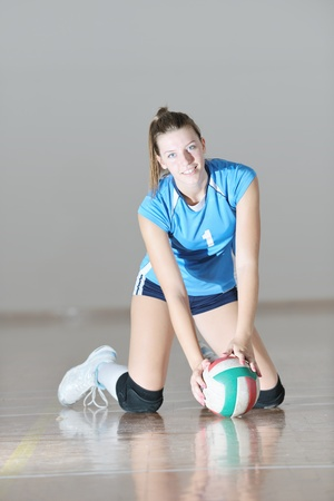 one young girl playing volleyball game sport  indoor Stock Photo - 10778254