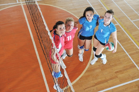 volleyball game sport with group of young beautiful  girls indoor in sport arena Stock Photo - 10778293