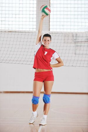 one young girl playing volleyball game sport  indoor photo