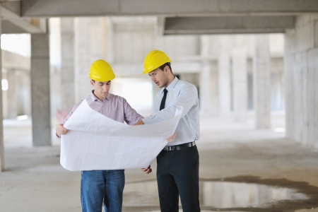 Team of business people in group, architect and engeneer  on construciton site check documents and business workflow on new building Stock Photo - 10877152