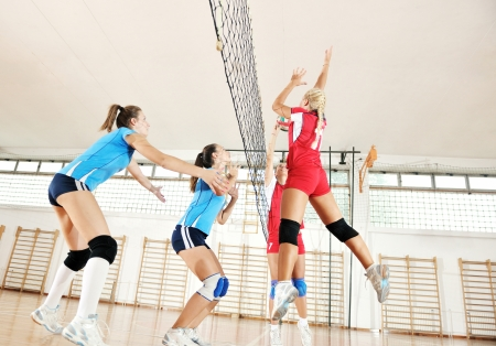 matches: volleyball game sport with group of young beautiful  girls indoor in sport arena Stock Photo