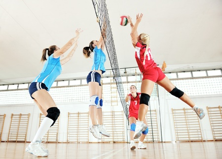 volleyball game sport with group of young beautiful  girls indoor in sport arena Stock Photo
