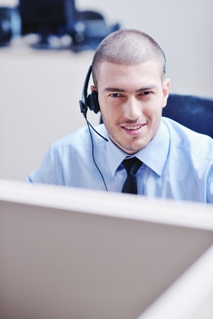 businessman with a headset portrait at bright call center helpdesk support office Stock Photo - 10951247