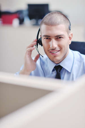 personal call: businessman with a headset portrait at bright call center helpdesk support office Stock Photo