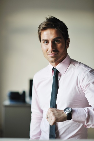 portrait of one young business man at bright office indoor photo