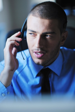 businessman with a headset portrait at bright call center helpdesk support office Stock Photo - 10951261