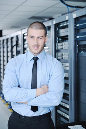 young handsome business man  engineer in datacenter server room photo