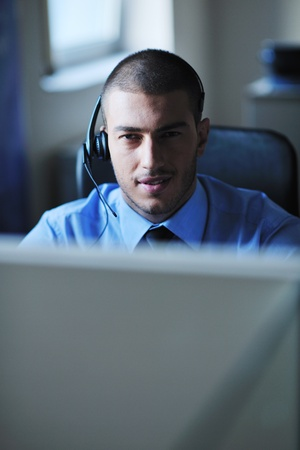 businessman with a headset portrait at bright call center helpdesk support office Stock Photo - 11022427