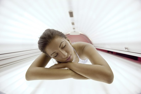 tanning: Beautiful young woman have tanning skin treatment in modern solarium