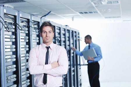 group of young business people it engineer in network server room solving problems and give help and support Stock Photo - 11022773