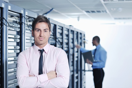 data backup: group of young business people it engineer in network server room solving problems and give help and support