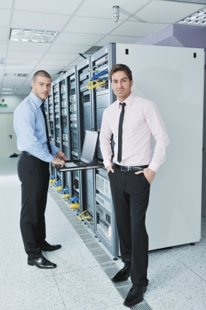 group of young business people it engineer in network server room solving problems and give help and support photo