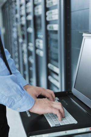 young handsome business man  engeneer in datacenter server room photo