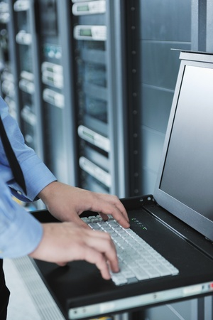 firewalls: young handsome business man  engeneer in datacenter server room
