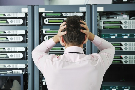 isp: it business man in network server room have problems and looking for  disaster situation  solution