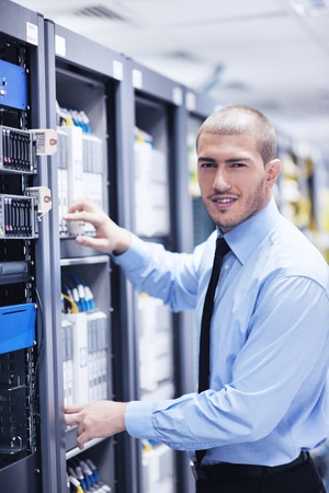 young handsome business man  engeneer in datacenter server room photo