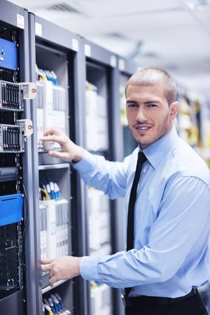 young handsome business man  engeneer in datacenter server room Stock Photo - 11022963