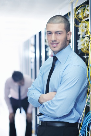 group of young business people it engineer in network server room solving problems and give help and support Stock Photo - 11023161