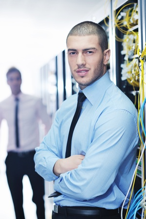 group of young business people it engineer in network server room solving problems and give help and support Stock Photo - 11023168