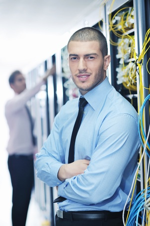 group of young business people it engineer in network server room solving problems and give help and support Stock Photo - 11023175